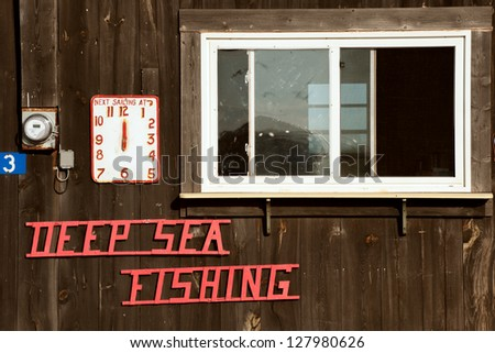 Deep Sea Fishing sign on Prince Edward Island oceanshore