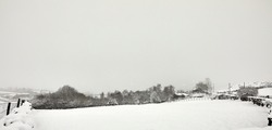 Deep snow after daylong snowfall on moorland smallholding in Nidderdale.