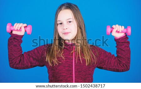 Deep squat. Happy child sportsman with barbell. workout of small girl hold dumbbell. weight lifting for muscules. Childhood activity. Fitness diet for energy health. Sport success. One more squat.