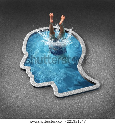 Deep thinking and soul searching concept with a person diving into a swimming pool shaped as a human face as a symbol of self examination and mental health related to inner feelings and emotions.