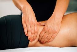 Deep tissue massage detail. Tanned woman enjoying deep tissue massage