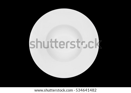 Deep white small soup plate with wide shoulders on black background from above
