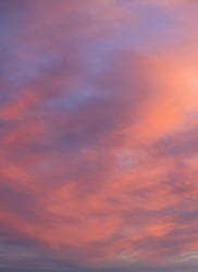 Deeply purple clouds on sunset background
