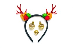 Deer muzzle is made of rim with deer horns and ears, golden Christmas golden balls, bell isolated on white background Creative flat lay composition Merry Christmas, Happy new year concept Top view