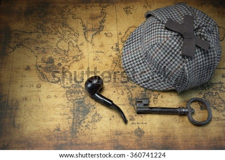Deerstalker Sherlock Holmes Hat, Vintage Key And Smoking Pipe On The Old World Map Background. Overhead View.  Investigation Concept.