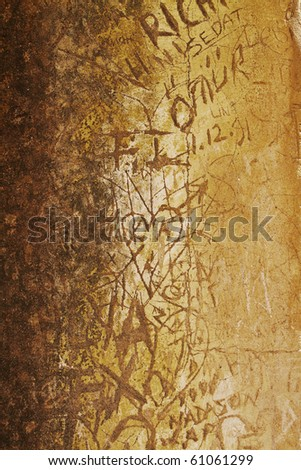defaced ancient culture wall with carved graffiti in Ephesus, Turkey.
