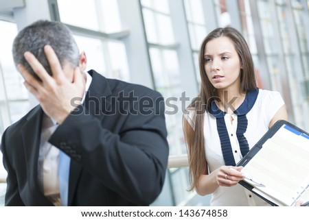 Defeated businessman turns away form coworker - stock photo