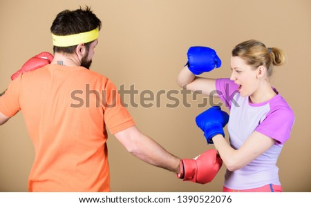 Defense wins championships. punching, sport Success. sportswear. Fight. Happy woman and bearded man workout in gym. training with coach. knockout and energy. couple training in boxing gloves. #1390522076