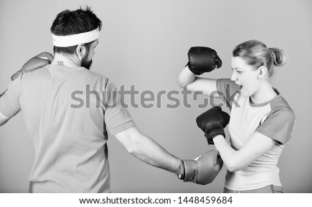 Defense wins championships. punching, sport Success. sportswear. Fight. Happy woman and bearded man workout in gym. training with coach. knockout and energy. couple training in boxing gloves. #1448459684