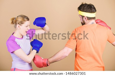 Defense wins championships. punching, sport Success. sportswear. Fight. Happy woman and bearded man workout in gym. training with coach. knockout and energy. couple training in boxing gloves.