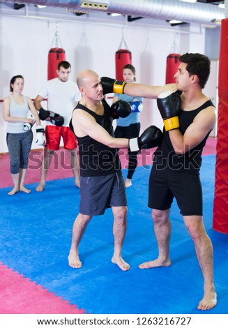 Defferent ages sportsmen competing in boxing gloves