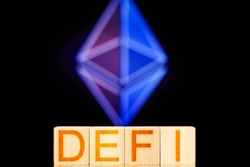 defi concept. wooden blocks with defi lettering on ethereum cryptocurrency icon background