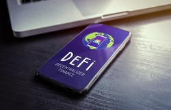 DeFi - Decentralized Finance includes digital assets, smart contracts, protocols, and dApps built on a blockchain technology. Fintech concept with smartphone lying on a wooden table
