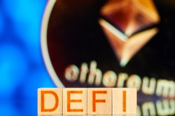 defi. wooden blocks with defi inscription and ethereum cryptocurrency on the background
