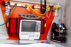 Defibrillator is seend inside of an ambulance. Defibrillation is a treatment for life-threatening cardiac dysrhythmias delivering a dose of electric current to the heart.