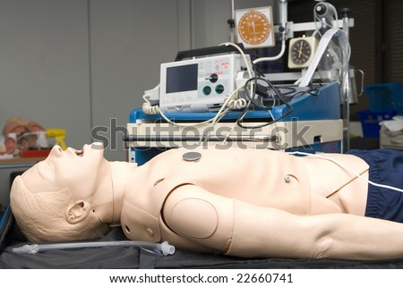 Defibrillator on a dummy for practice