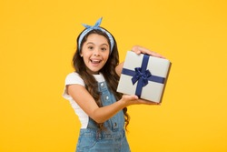 Definite must. black friday discount. summer shopping sales. best presents and gifts. little girl open box. surprised kid on yellow background. birthday surprise for her. bargain sale concept.
