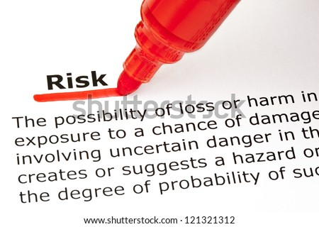 Definition of the word Risk, underlined with red marker - stock photo