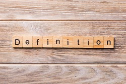 Definition word written on wood block. Definition text on wooden table for your desing, concept.
