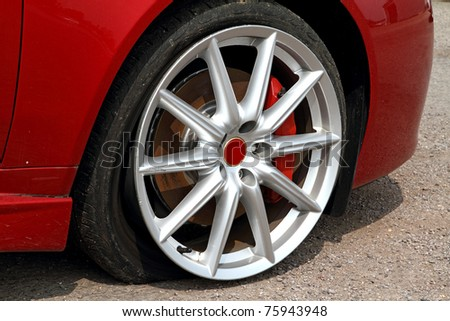 Deflated tyre damage to car wheel