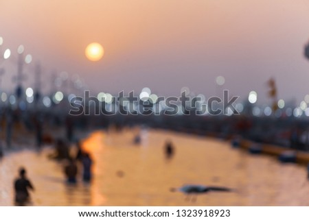 Defocoused scene of beautiful sunrise with reflection on river water at Allahabad (India) Kumbh 2019. #1323918923
