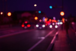 Defocus and blur image of city at night, Blur traffic road with bokeh light abstract background. Retro pink light style