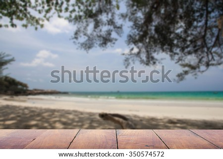 Defocus And Blur Image Of Terrace Wood And Beautiful Sea Image Of Blurred  Sunbed At Beach