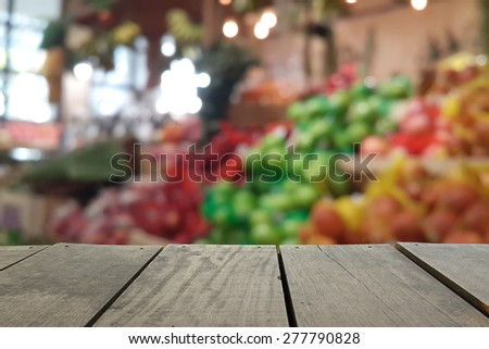 Defocus and blur image of terrace wood and Supermarket blur background in Fruits and Vegetables devision for background usage