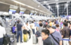 Defocus Blurry passengers people of crowd anonymous check in at counter the airport. scene of airport with passengers activity. Terminal Departure Check-in at airport. Travel International concept.
