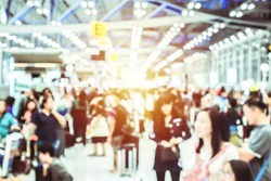 Defocus Blurry passengers people of crowd anonymous walking at the airport. scene of airport with passengers activity. Terminal Departure Check-in at airport. Travel International concept.