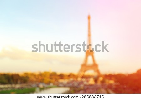defocus bokeh blurred of silhouette eiffel tower in Paris with sunset, great for your design and background