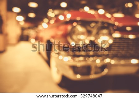 defocus or blur image of retro car and motorcycle, effect by vintage style #529748047