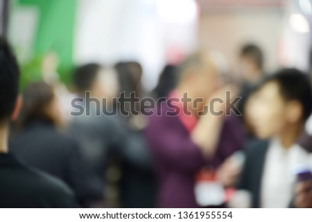 Defocus people backgrounds in trade show,Zhongshan,Guangdong,China. Abstract background used for business. #1361955554
