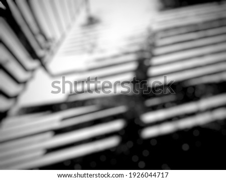Defocused abstract background blurry black and white  picture of a fence shadow reflected on the floor with .  ストックフォト ©