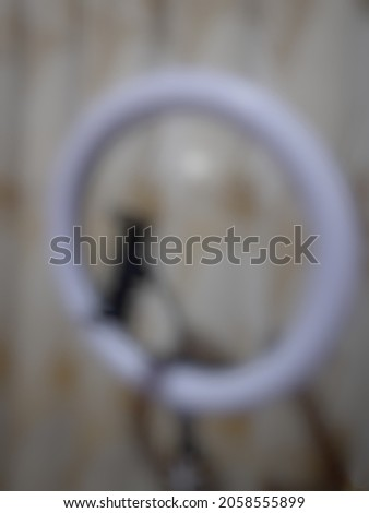 Defocused abstract background of a ring light.