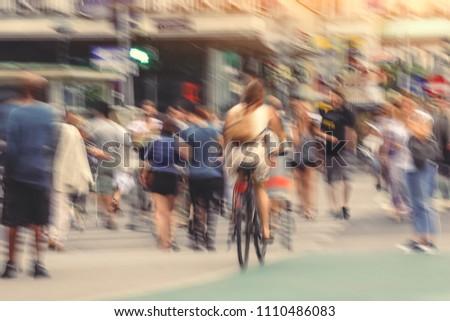 Defocused abstract blur background of people cross street