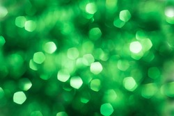 Defocused abstract green background. Blurred holiday bokeh.