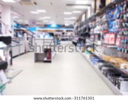 Defocused and blurred interior electronics store, with long shelves with goods. the image was blurred for use as a background