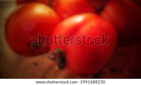 defocused background blur lens of fresh red tomato with light