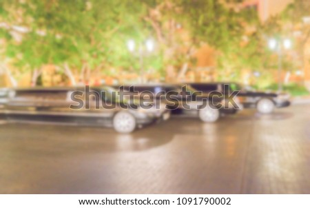 Defocused background of 3 black luxury Limos. Intentionally blurred post production for bokeh effect