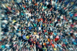 Defocused background of crowd of people in a stadium at a baseball match