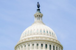 Defocused background of the United States Capitol building, Washington DC, USA. Intentionally blurred post production for bokeh effect