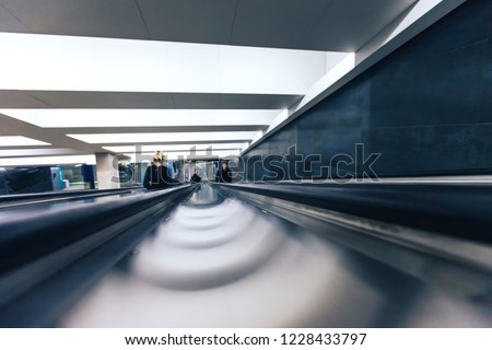Defocused Background. Staircase Escalator Inside the Underground Subway Metro Station