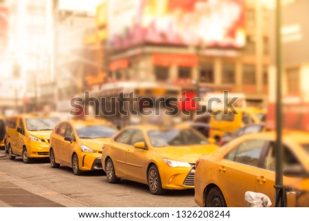 c1ae898c0451d Defocused blur of a line of New York City yellow taxi cabs at rush hour in