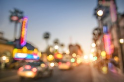 Defocused blur of Hollywood Boulevard at sunset - Bokeh abstract view of world famous Walk of Fame in California - United States of America wonders - Emotional saturated filter with powered sunshine