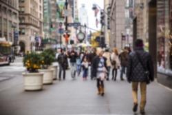 Defocused blur of New York City street with crowd of people walking
