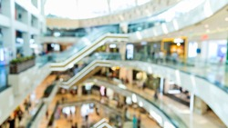 Defocused blur of people on shopping mall.