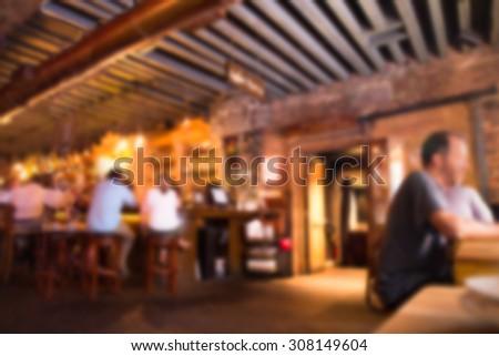 Defocused blur of scene inside restaurant pub and bar