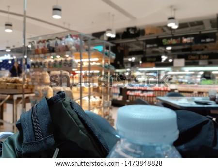 Defocused blur products on shelf in supermarket #1473848828
