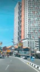 Defocused blurred photo of the city street from Indonesia and building in blue sky